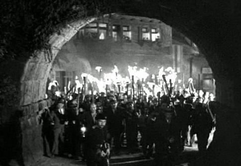 A stereotypical angry mob from one of the Frankenstein movies