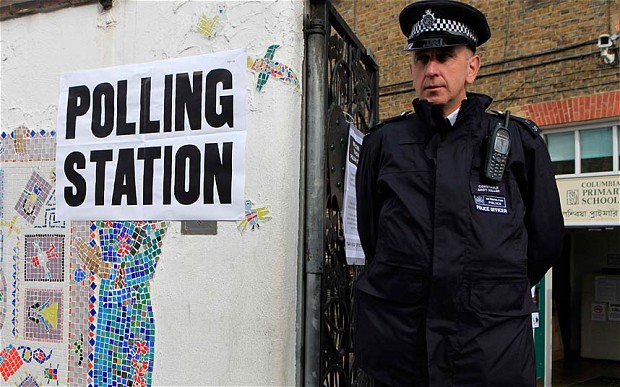 Police outside a polling station in Tower Hamlets in order to deter voters from being intimidated
