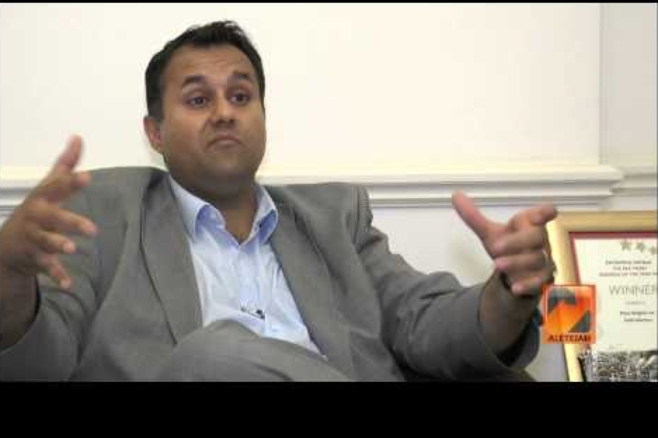 Fiyaz Mughal of the Tell Mama organisation, and no I wouldn't buy a used car off him either. In that pic he does look as if he's saying 'hey, some of my BS is this big'