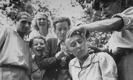 Woman accused of collaboration with the Nazis gets publicly shamed by having her head shaved by members of the French Resistance.